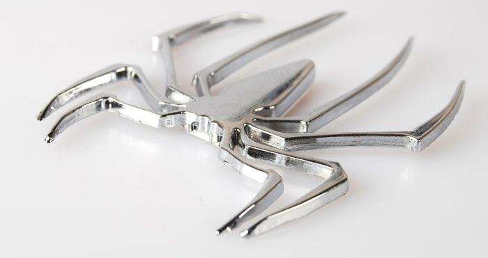 Spindel i krom - Emblem